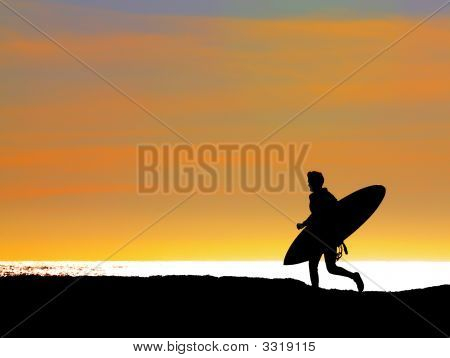 Surfer Running Out To Sea