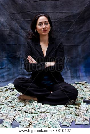 Woman Sitting In Money