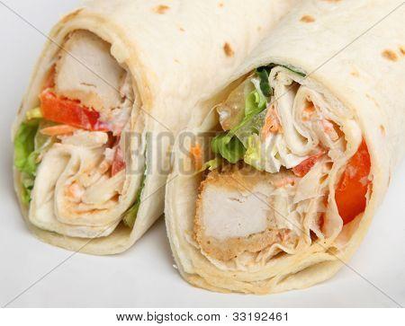 Southern fried chicken wrap sandwich. Selective focus on RH wrap.