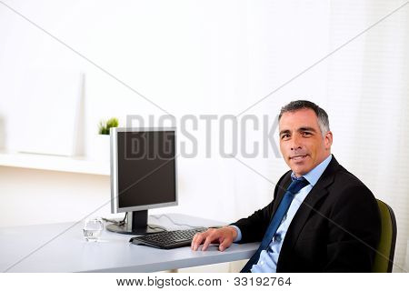 Charismatic Executive Working At The Office