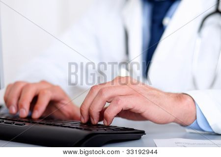 Doctor Hands Using A Computer