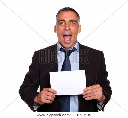 Attractive Man Holding A White Card With Copyspace