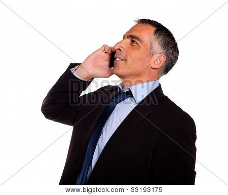 Hispanic Professional Man Conversing With A Mobile