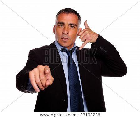 Hispanic Senior Broker Pointing
