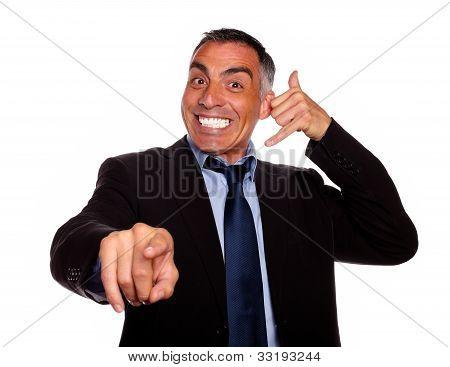 Hispanic Senior Businessman Pointing