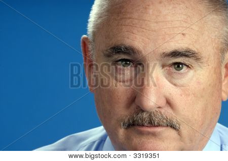 Older Businessman In Close Up