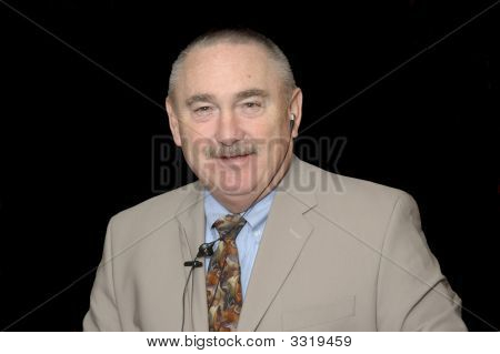 Baby-Boomer Businessman In A Suit Isolated On Black