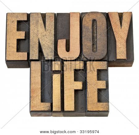 enjoy life - isolated text in vintage letterpress wood type