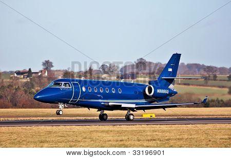 Blue bizzjet landing