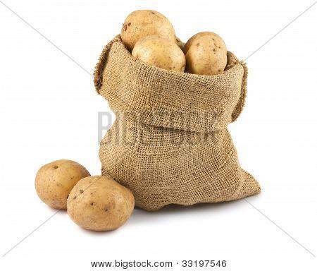 Raw Potatoes In Burlap Sack