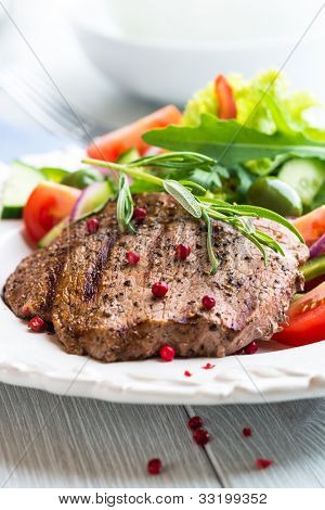 Grilled Beef Steak with Rosemary and Salad