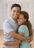 image of adoration  - Hispanic couple hugging - JPG