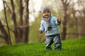Cute little boy in a spring park