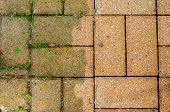 foto of dingy  - Patio bricks showing the difference made by power washing - JPG
