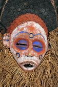 image of african mask  - Traditional Tribal African Mask with straw beard and blue colored eyes - JPG
