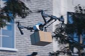 Drone Quadcopter Delivering Package To Buyer Flying At The Street. Modern Service And Delivery. 3d R poster