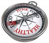 foto of junk  - healthy versus junk food concept compass with black red letters isolated on white background - JPG