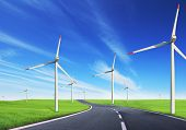 stock photo of global-warming  - Windmills field with road - JPG