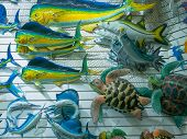 Colorful Souvenir Background. Hanging Decoration In The Market. Handmade Fish Hanging On The Tourist poster