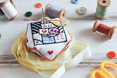 Handmade And Needlework. Handmade Pin Cushion With A Simple Ornament And Sewing Supplies On The Whit poster