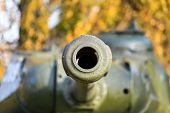 Barrel With A Tank Close-up. A Close Up Shot Of A Rusty Military Tank Gun, Tank Canon. The Barrel Of poster