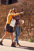 Beautiful Happy Couple Walking On Street on vacation with sightseeing city with map poster