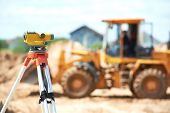 pic of theodolite  - Surveying measuring equipment level theodolite on tripod at construction building area site - JPG