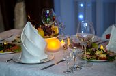 Beautiful Festive Table Setting. White Tablecloth With White Napkins. Delicious Snack On Their Plate poster