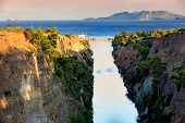The Corinth Canal In The Morning Summer Day Illuminates The Bright Rising Sun Of Greece, A View Of T poster