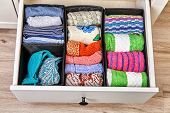 The Drawer Is Divided Into Cells Of Different Sizes, For Separate Storage Of Linen And Fabrics. Home poster