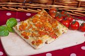 image of nic  - Typical italian focaccia bread with cherry tomatoes on top - JPG