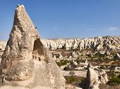 Remains Of Rock-cut Christian Temples At The Rock Site Of Cappadocia Near Goreme poster