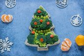 Creative Edible Christmas Tree Of Fresh Broccoli Next To Christmas Tree And Tangerines.concept: Vega poster