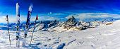 Ski in winter season, mountains and ski touring backcountry equipments on the top of snowy mountains poster