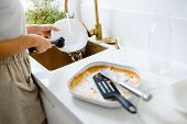 Close Up Of Dirty Dishes. Woman Washing The Dishes In Kitchen poster