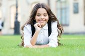 Child Back To School And Looking Cool. Happy Small Child Relax On Green Grass. Little Child Smiling  poster