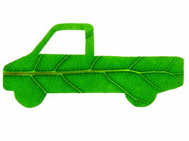 image of non-biodegradable  - The stylised form of a truck that has been cut from a green leaf  - JPG