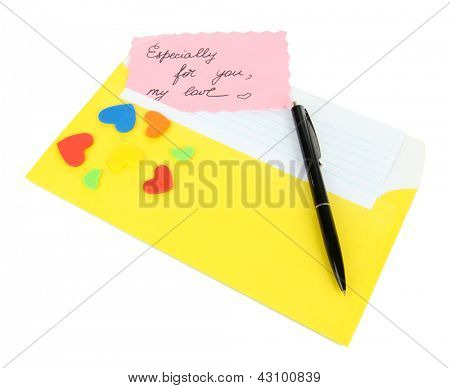 Note in envelope with pen isolated on white