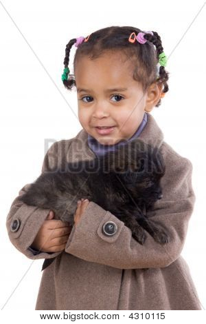 African Baby Holding A Puppy On Her Arms
