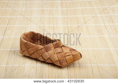 bast, ancient russian shoes on wooden floor