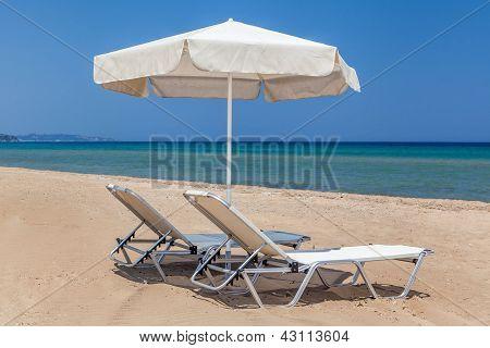 Sun Beds And Sun Umbrella On The Beach