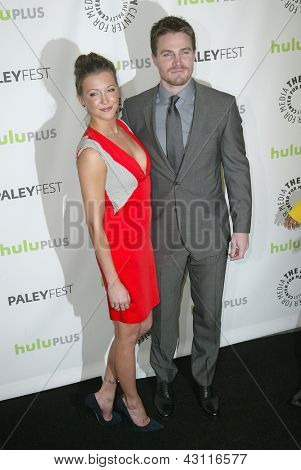 BEVERLY HILLS - MARCH 9: Katie Cassidy and Stephen Amell arrive at the 2013 Paleyfest