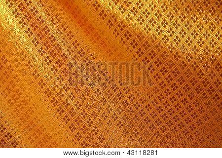 Fondo de textura de seda dorada