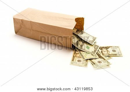 Brown paper bag with United States twenty dollar bills