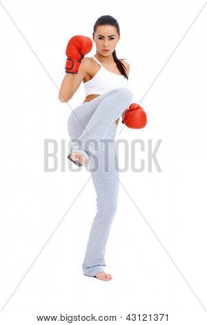 Full body shot of female kick boxer over white background