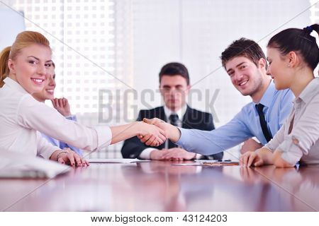 business people shaking hands make deal and sign contract in bright modern office