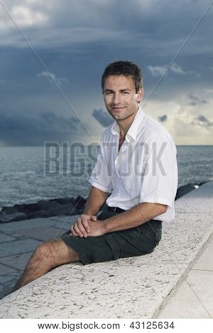 Man posing by the sea