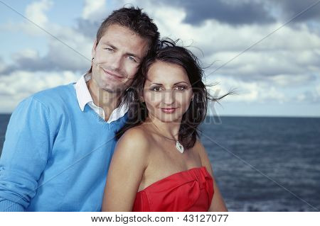 Nice couple posing by the sea