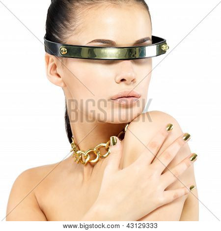 Portrait Of Woman With Golden Nails And Gold Chain
