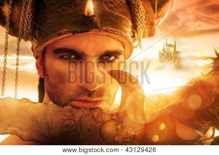 Portrait of a seexy strong warrior holding sword in golden light with fantasy background